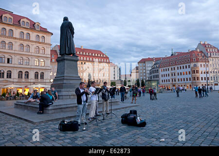 street musicians at the Martin Luther statue  on Neumarkt new market square  in Dresden, Saxony, Germany, Europe - Stock Photo