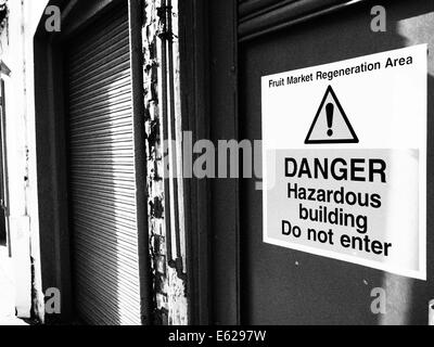Enter at your own risk - Stock Photo