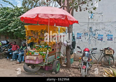 Roadside fruit and vegetable stall with umbrella shade in Nairobi South C district Kenya Africa - Stock Photo