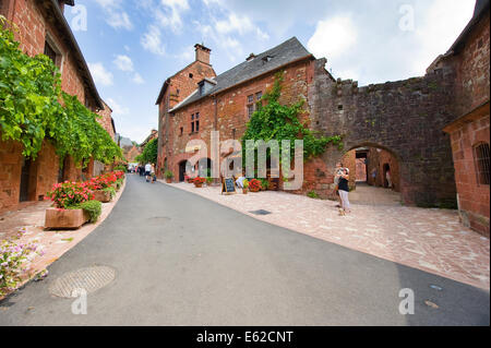 All the houses in the small picturesque city of Collonges la Rouge in France are built with red bricks - Stock Photo