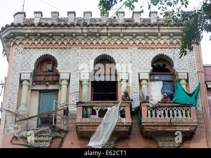 two old women on balcony, Central Havana, Cuba - Stock Photo