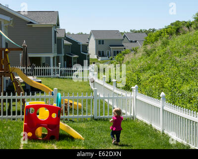 Small Child Plays in Backyard of  Army Officer Housing, United States Military Academy, West Point, NY, USA - Stock Photo