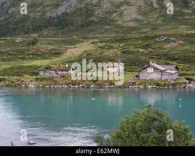 Old shieling in Norwegian mountains, most of them are now used as holiday cottages, Jotunheimen Norway - Stock Photo