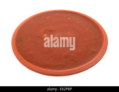 A small bowl of jalapeño salsa sauce on a white background. - Stock Photo