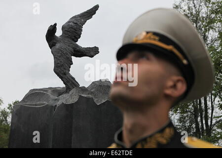 St. Petersburg. 12th Aug, 2014. A soldier attends a ceremony in memory of soldiers who died in the Kursk submarine - Stock Photo