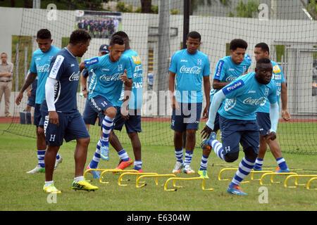 Tegucigalpa, Honduras. 12th Aug, 2014. Honduras' National Team manager Carlos Pavon Plumer (2nd L) directs players - Stock Photo
