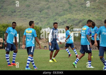 Tegucigalpa, Honduras. 12th Aug, 2014. Honduras' National Team manager Carlos Pavon Plumer (C) directs players during - Stock Photo