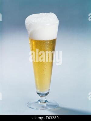 1950s 1960s BEER IN PILSNER GLASS WITH FOAMY HEAD - Stock Photo