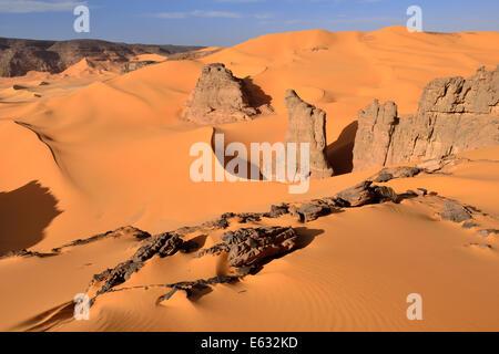 Rocks and sand dunes of Moul Naga, Tadrart region, Tassili N'Ajjer National Park, Unesco World Heritage Site, Sahara, - Stock Photo