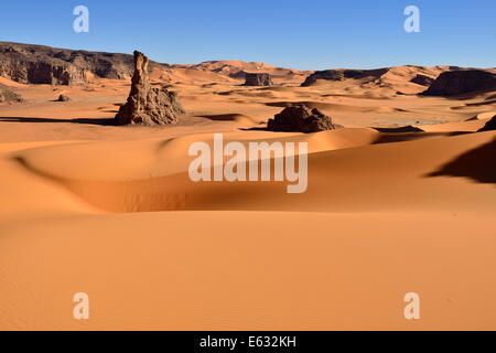 Sand dunes and rocks of Moul Naga, Tadrart, Tassili n'Ajjer National Park, Unesco World Heritage Site, Sahara, Algeria - Stock Photo