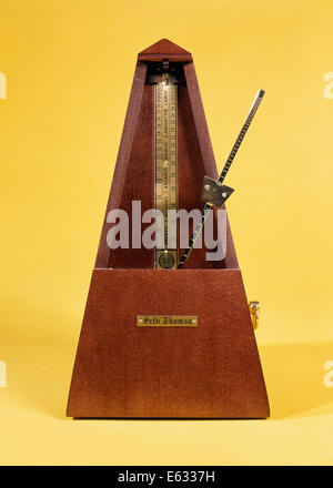 WOODEN AND BRASS METRONOME - Stock Photo