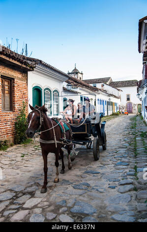 Horse cart with tourists, Paraty, Rio de Janeiro State, Brazil - Stock Photo