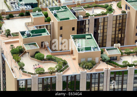 Aerial View of Roof Top Gardens and Roof Terraces Atop Luxury High-Rise Apartments or Apartment Building in Monaco - Stock Photo