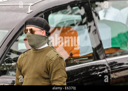 Belfast, Northern Ireland. 13 August 2014. Paramilitary funeral of veteran IRA volunteer Tony Catney Credit:  Stephen - Stock Photo