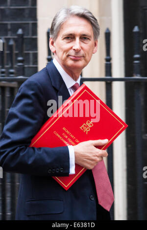 London, UK. 13th Aug, 2014. Foreign Affairs secretary Philip Hammond arrives at 10 Downing Street to chair a COBR - Stock Photo