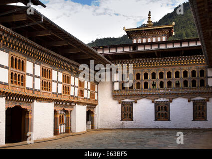 Eastern Bhutan, Lhuentse, Rinchentse Phodrang Dzong inner courtyard decorated in traditional style - Stock Photo