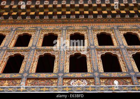 Eastern Bhutan, Lhuentse, Rinchentse Phodrang Dzong window decorated in traditional style - Stock Photo