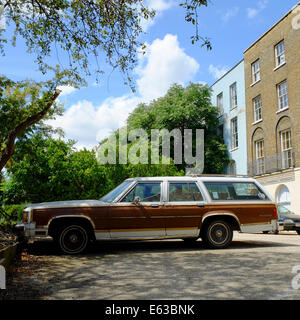 American Station wagon estate car parked in drive of London house - Stock Photo