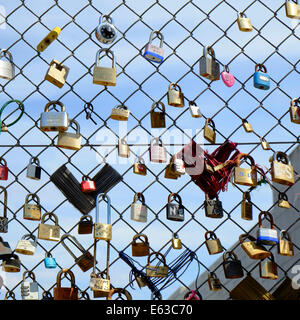 Love Locks on chain link fence in Shoreditch, London - Stock Photo