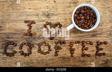 I love coffee sign created from coffee beans and a cup filled with coffee beans. - Stock Photo