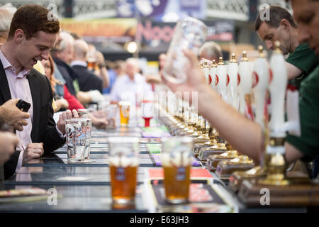 London, UK. 13th Aug, 2014. The Great British Beer Festival at Olympia exhibition centre. A yearly beer festival - Stock Photo