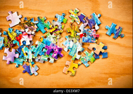 jigsaw puzzle pieces scattered - Stock Photo