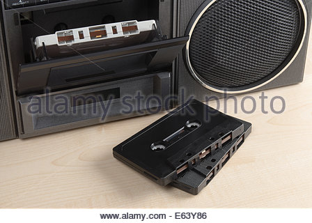 Closeup of an old radio cassette player with two cassettes in front - Stock Photo
