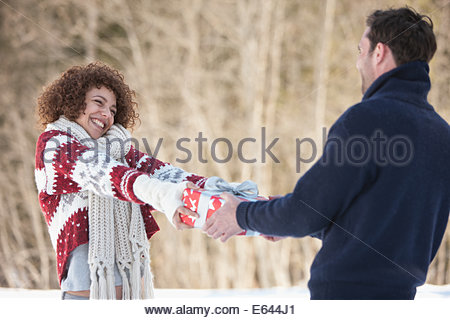 Woman giving man gift - Stock Photo