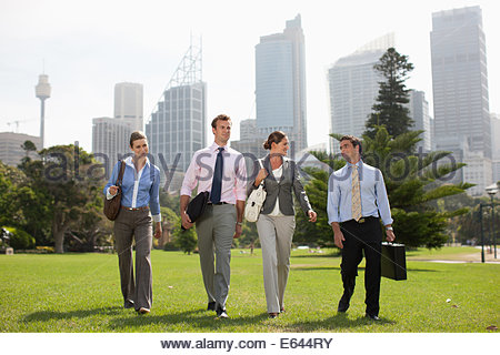 Business people walking together outdoors - Stock Photo