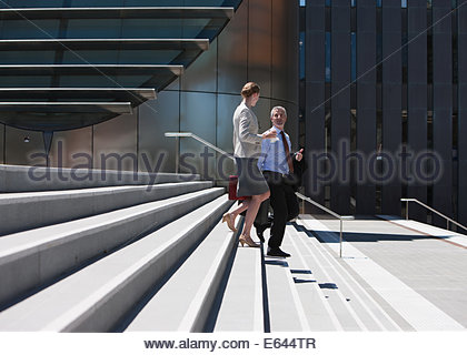 Business people walking down steps - Stock Photo