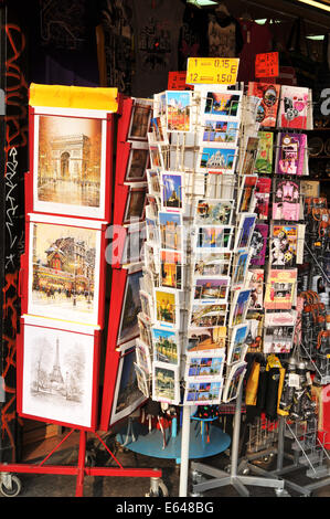 PARIS, FRANCE - MARCH 29, 2011: Various postcards from Paris for sale are displayed in front of souvenir shop - Stock Photo
