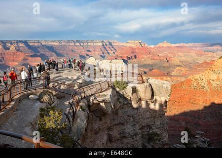 People watching sunset from viewpoint at Grand Canyon South Rim. Arizona, USA. - Stock Photo