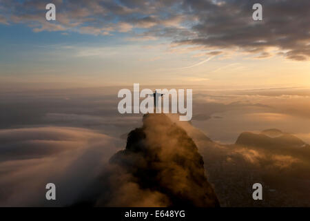 The giant Art Deco statue Jesus known as Cristo Redentor (Christ Redeemer) on Corcovado mountain in Rio de Janeiro - Stock Photo