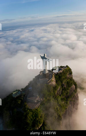 The giant Art Deco statue Jesus known as Cristo Redentor (Christ Redeemer) on Corcovado mountain in Rio de Janeiro - Stock Photo