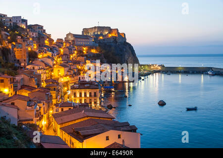 Town View at dusk, with Castello Ruffo, Scilla, Calabria, Italy - Stock Photo