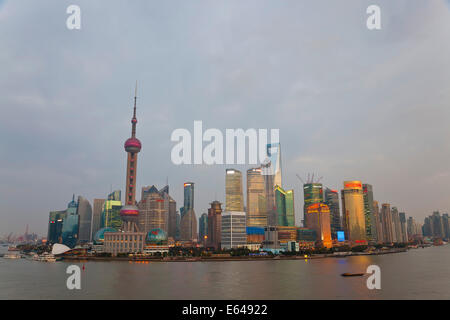 Barges and Pudong skyline, Shanghai, China - Stock Photo