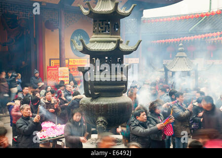 Burning incense, Jade Buddha Temple, Shanghai, China - Stock Photo