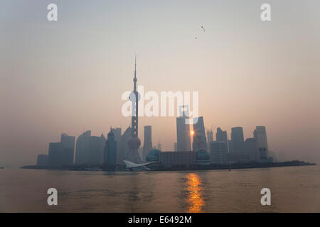 Sunrise over Pudong skyline, Shanghai, China - Stock Photo