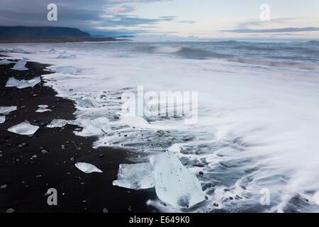 Icebergs on beach Jokulsarlon Glacial Lagoon, Iceland - Stock Photo