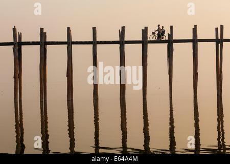 U Bein Teak Bridge at sunrise, Mandalay, Myanmar - Stock Photo