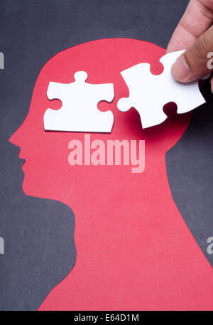 Jigsaw puzzle pieces on the human head - Stock Photo