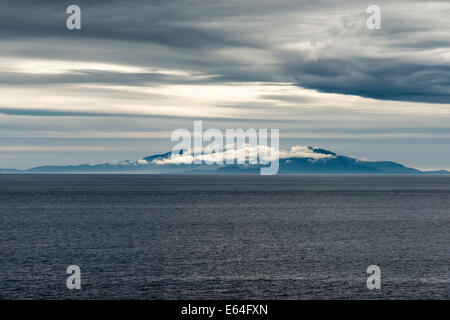 The Hebredean Island of Benbecula seen from the Isle of Skye Scotland on a misty evening - Stock Photo