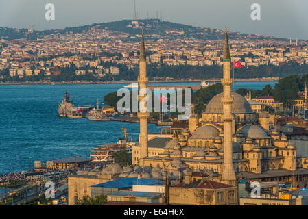 The New Mosque (Yeni Cami) among the Istanbul cityscape in early evening. - Stock Photo