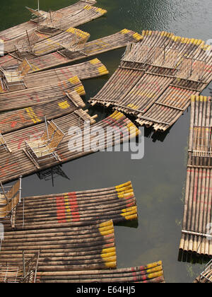 Bamboo rafts randomly moored on the Li River Guilin China - Stock Photo