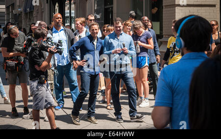 New York, US. 14th Aug, 2014. Seth Meyers, center, host of Late Night with Seth Meyers on NBC walks down Fifth Avenue - Stock Photo