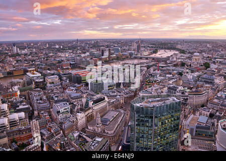 General view of buildings of the city skyline at dusk in London, England - Stock Photo