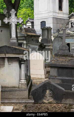 Graves and tombs in Pere Lachaise Cemetery Paris, France - Stock Photo