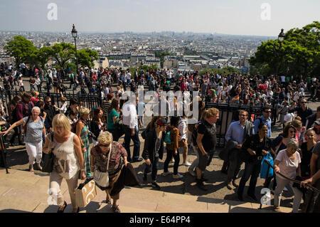 Tourists at the Sacred Heart Basilica of Montmartre [ Basilique du Sacré-Coeur de Montmartre] Paris, France - Stock Photo