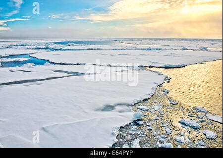 Pack ice breaking up in Svalbard in the arctic north of Norway. - Stock Photo