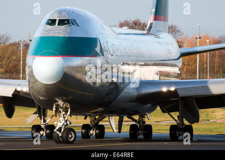 Cathay Pacific Cargo Boeing 747-400 lines up on runway 23R at Manchester airport. - Stock Photo